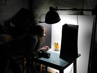 Behind the Scenes - Carrie photographing products for our website