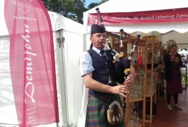 Pipe Major Alistair Duthie pipes at Demijohn during the Scottish Game Fair